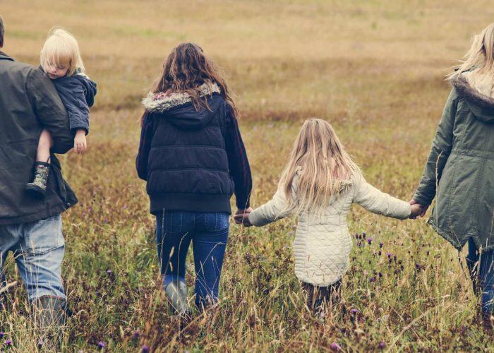 family walking through field